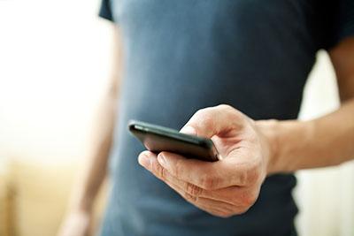 Man_Holding_Phone_Blis_Location_Advertising_Technology