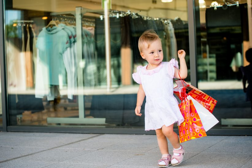 Cute baby goes shopping with bags, shops in background, How to Turn a Consumer into a Shopper