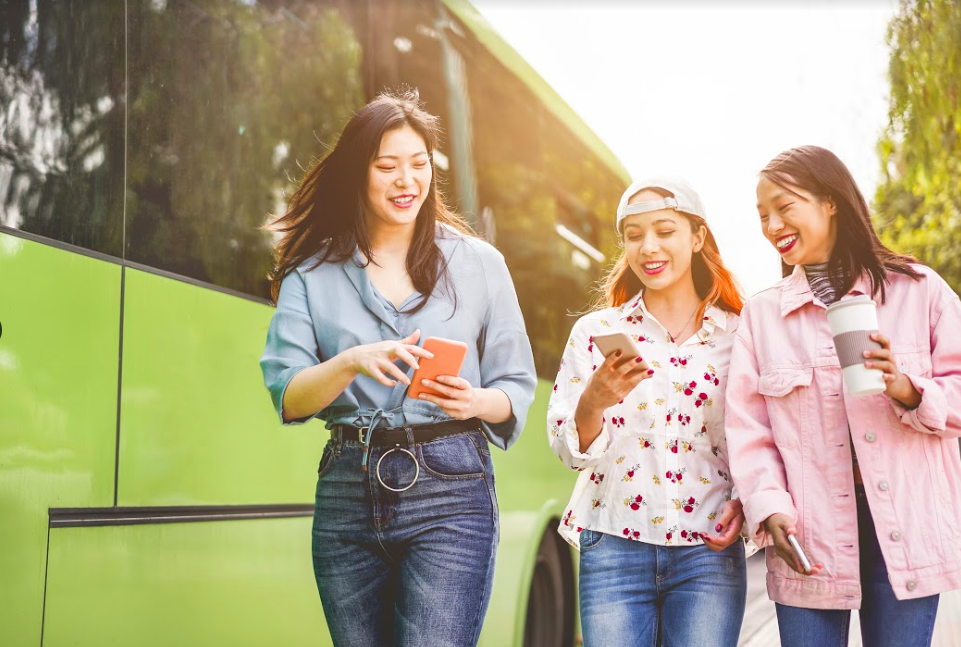 three-women-with-phones